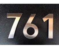 Números de acero inoxidable para casas en Av. Alsina