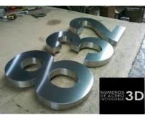 Números de acero inoxidable para fachadas en Av. Alsina