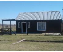 Vendo cabaña en barrio privado con quincho y garege y pileta