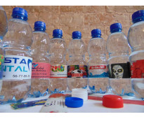 Tu marca e imagen en botellas con agua.